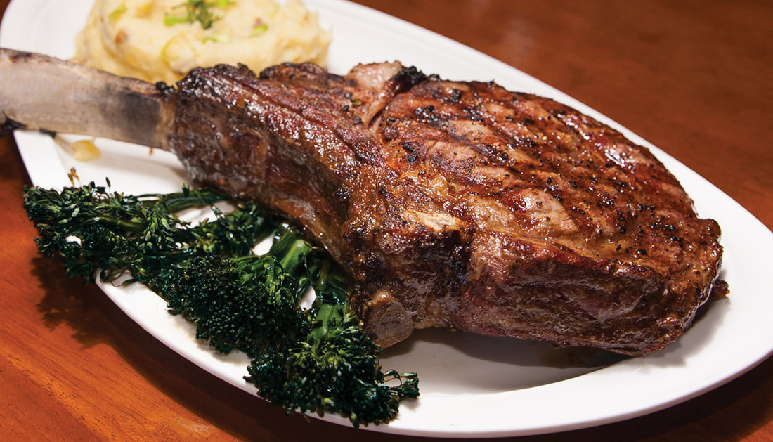 Longbone Ribeye Picture -- Mallory's Restaurant & Rooftop Bar, 