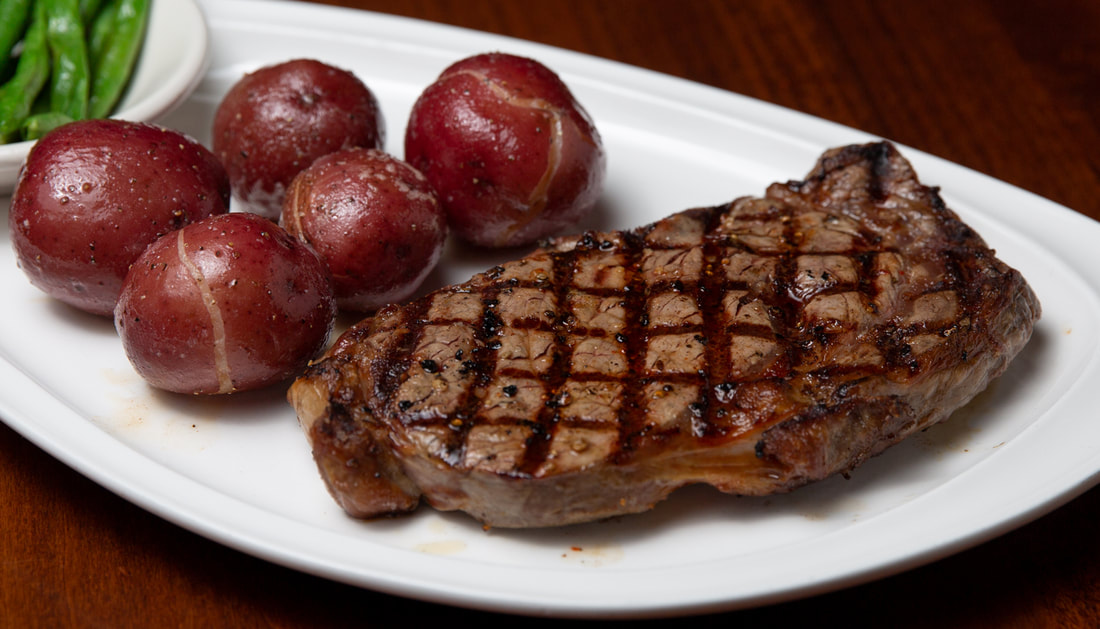 Ribeye -- Mallory's Restaurant & Rooftop Bar, © 2020