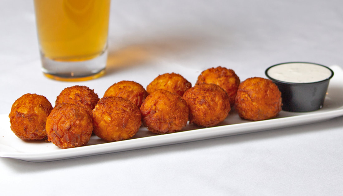 House Made Tots Picture -- Mallory's Restaurant & Rooftop Bar, 